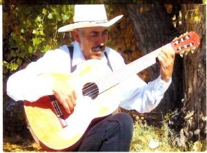 Cipriano Vigil playing guitar