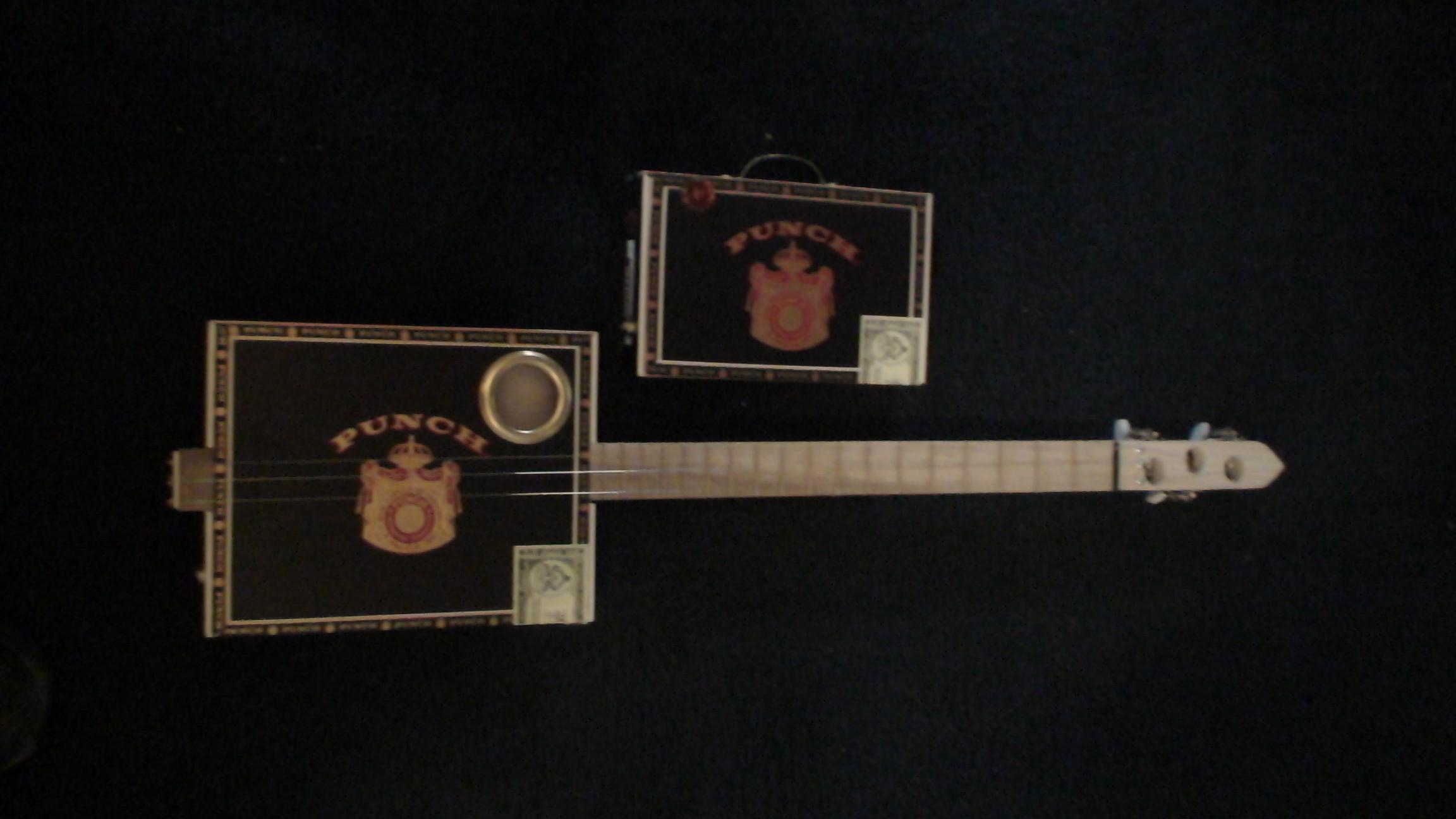 Cigar Box Guitar and Amp by Cipriano Vigil