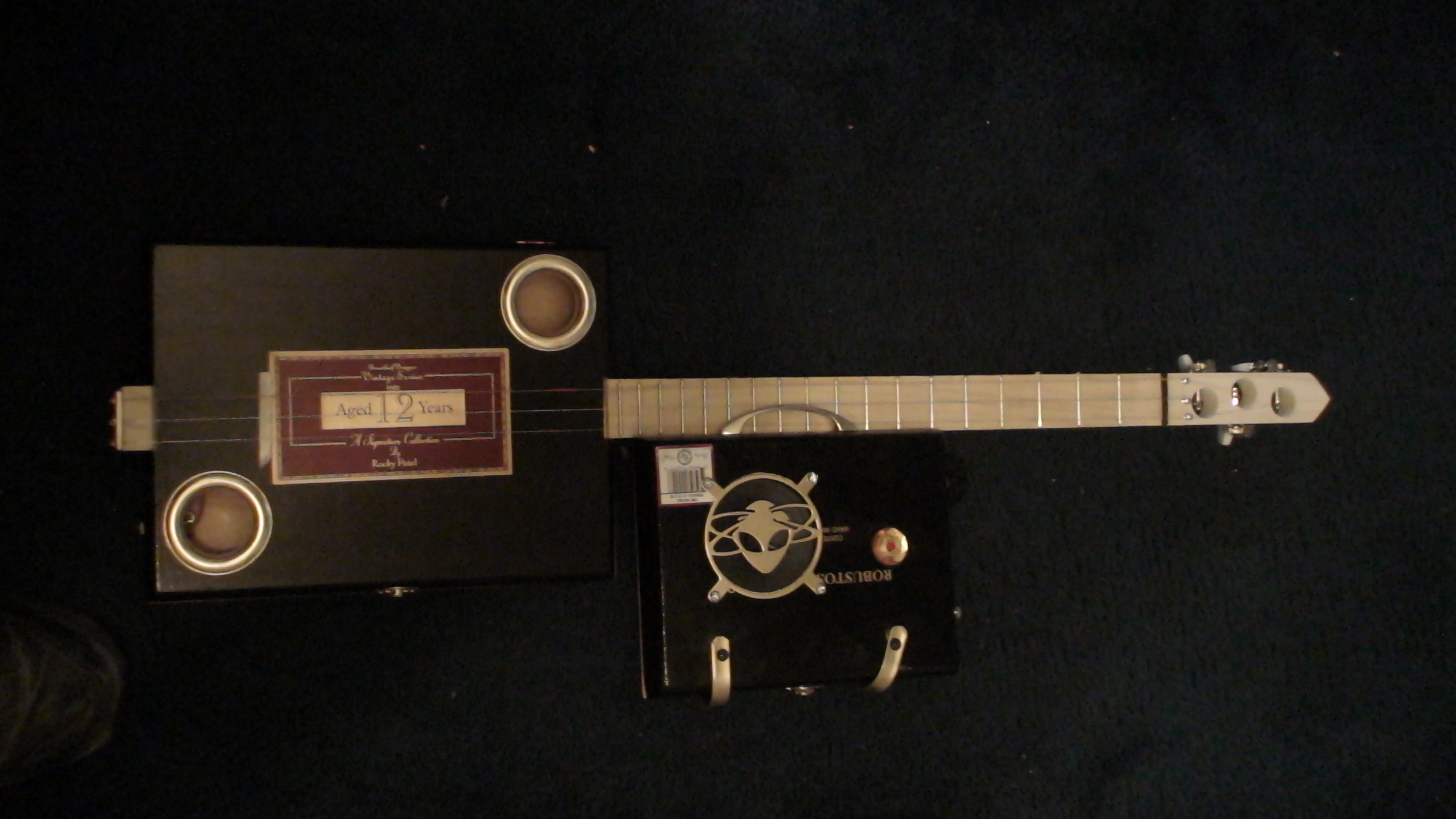 Cigar Box Guitar by Cipriano Vigil - Aged 12 Years