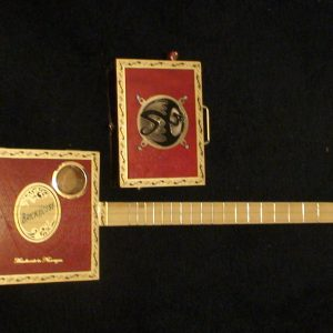 Brick House Cigar Box Guitar by Cipriano Vigil