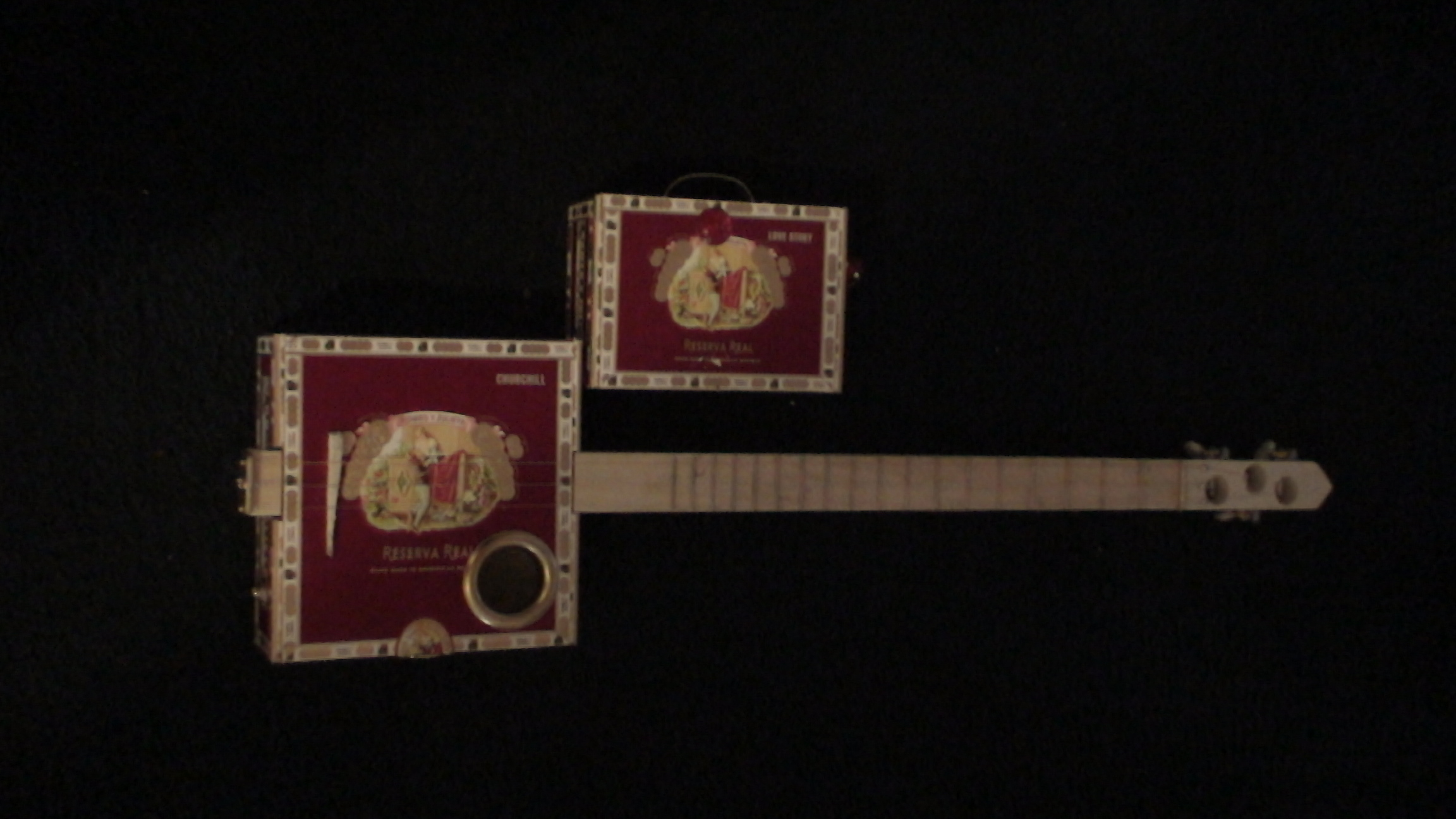 Romeo y Julieta Cigar Box Guitar by Cipriano Vigil