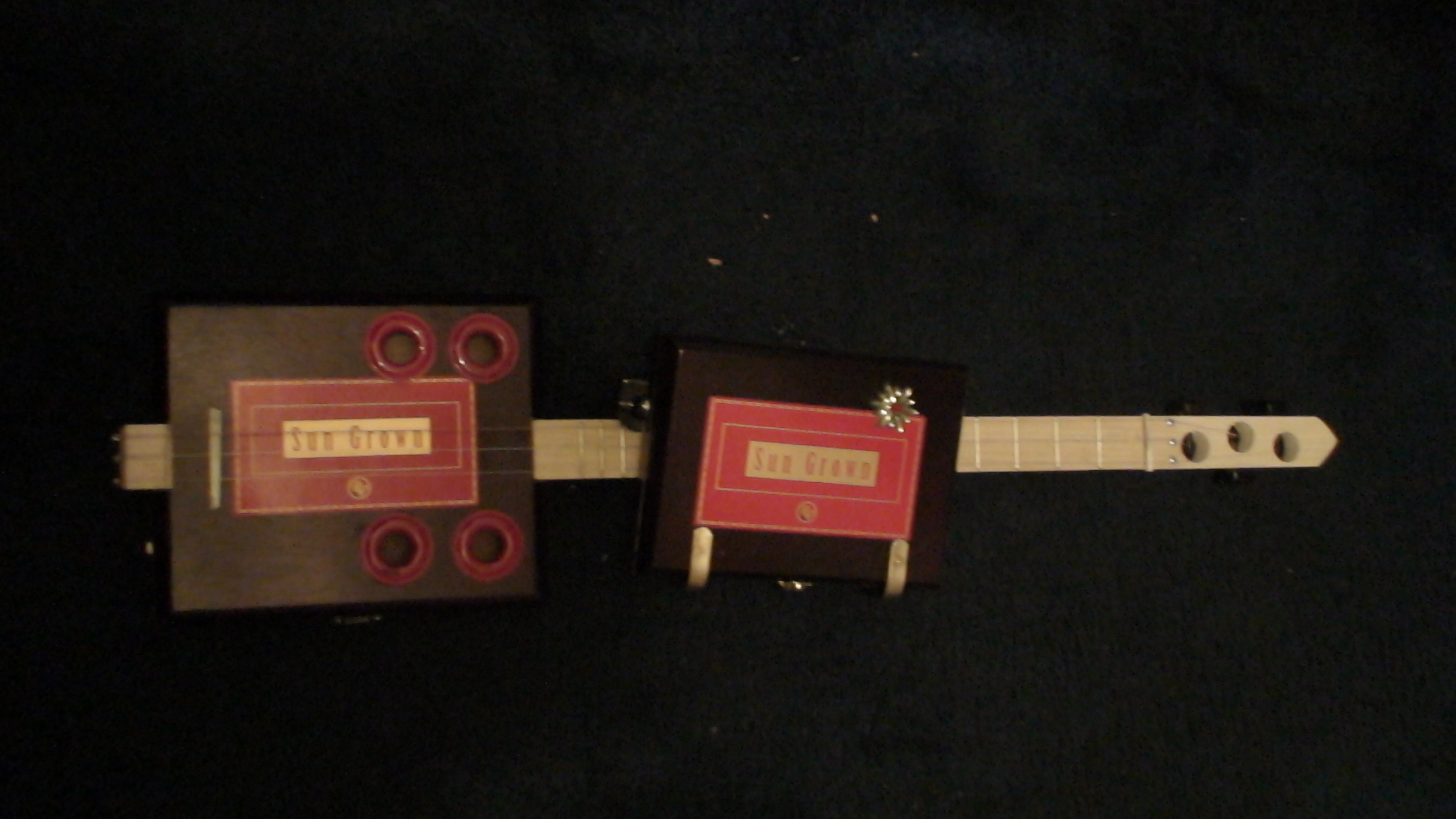 Sun Crown Cigar Box Guitar by Cipriano Vigil