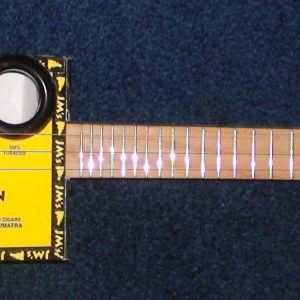 Yellow JM's Cigar Box Guitar by Cipriano Vigil